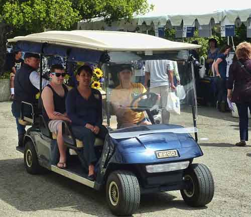 LaDawn Duvall, head of Visitor Services at Cal, and maestro of the day's activities was driven through the crowd in a golf cart taking blue and gold flowers from one event to the next.