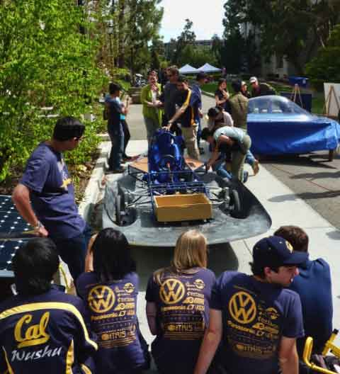 Engineering students displayed a solar electric car that they hope to take to Australia to compete in a distance contest.