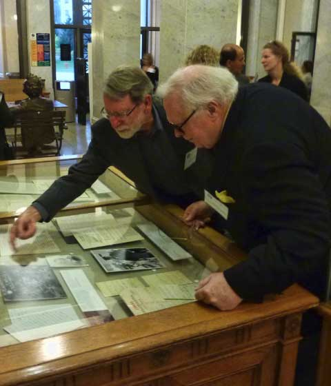 After the opening reception, curator William Roberts showed Kevin Starr a portion of the exhibit in the Bernice Brown Gallery in UC Berkeley's Doe Library.