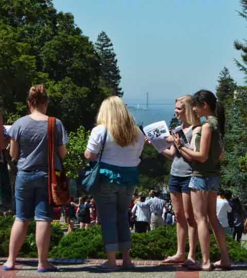 Visitors checked their programs at the top of Campanile Way, with the Golden Gate view in the distance.