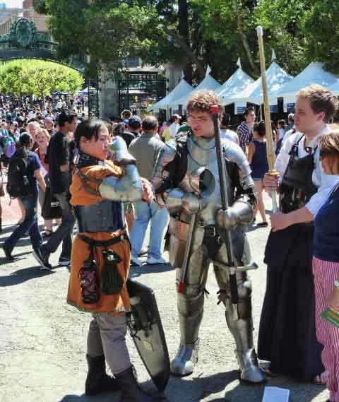 Students in armor from different eras and countries inside Sather Gate.