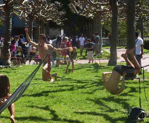 Slack line artists demonstrated their styles on the Campanile Esplanade as crowds lined up to ascend the adjacent tower.