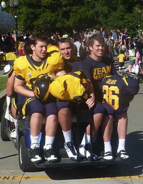 Cal Football players take a ride to their Spring Scrimmage at Edwards Track Stadium.