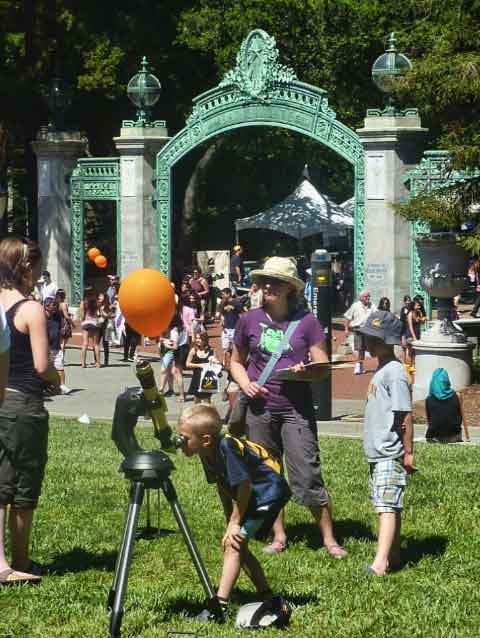 Student astronomers set up solar telescopes and a sun dial near Sather Gate.