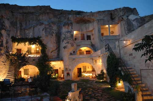 This is the view which Ken Sarachan gave Eddie Monroe, well-known Telegraph artist, when he requested an artist's rendering for his architect on the hippy hotel. The resort hotel in Cappadocia Turkey is carved from ancient rock formations. Carved steps to left are similar to those which will wend their way to the roof top gardens of the Hippy Hotel.