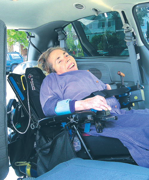 City Councilmember Dona Spring uses the AccessMobile's manual fold ramp to exit the van during a test drive Friday evening. City CarShare will launch the nation's first wheelchair-accessible CarShare van today (Tuesday) in partnership with the City of Berkeley at the Martin Luther King Jr. Civic Center.