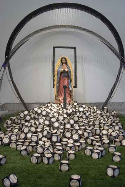 Kala Institute celebrates its 35th anniversary with RE:CON-FIGURE. Pictured here is an installation from the exhibit, Randy Hussong's Holy Mother of God That's a Lot of Baseballs! (2008). See story under Arts & Entertainment.