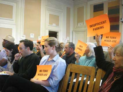 Southside Loft resident Molly Malone and other neighbors protest against the laundromat at the City Council meeting Tuesday. The council upheld the ZAB's decision to deny the laundromat a use permit.