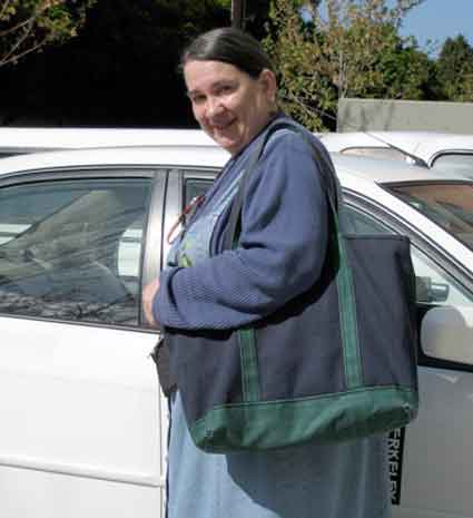 Colleen Fawley, an outreach specialist, getting into her car for her deliveries.