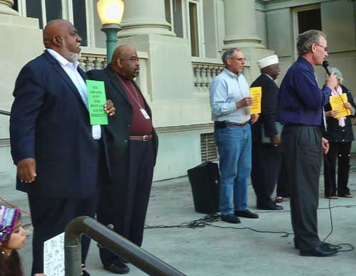 Councilmembers Darryl Moore, Max Anderson, and Laurie Capitelli stand behind rally emcee Dave Snyder.