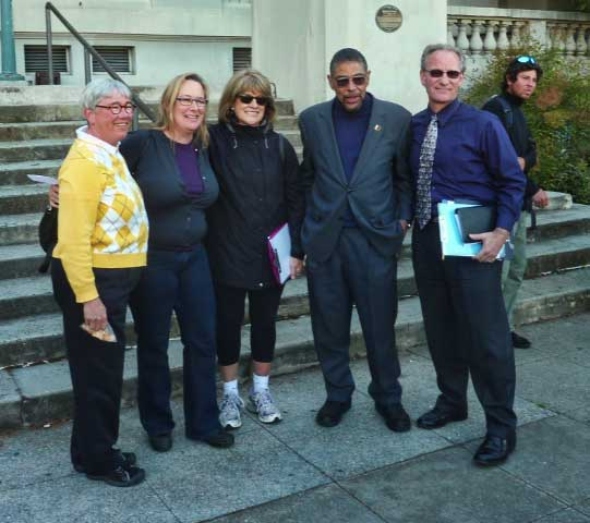 Some leaders of the branch library demolition / rebuild group gather for a photo after the rally.  They include from, left to right, Diane Davenport from the Friends of the Library, Elizabeth Watson and Linda Schacht of the Berkeley Public Library Foundation, Board of Library Trustees member Winston Burton, and Dave Snyder, executive director of the Foundation.