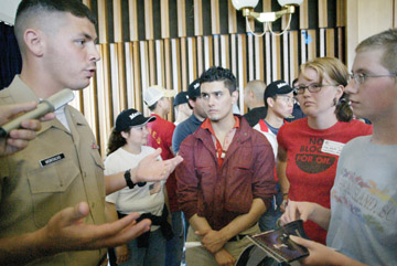 Jakob Schiller: Eric Montalvo, an officer selection officer with the Marine Corps' recruitment center in the Bay Area, was confronted last week at the UC Berkeley career fair by Stevie Hanley, Corrie Westing and Chelsea Collonge.a