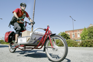 Jakob Schiller: Pedal Express worker-owner Keeth Koler makes one of several deliveries on Shattuck Avenue Monday afternoon..