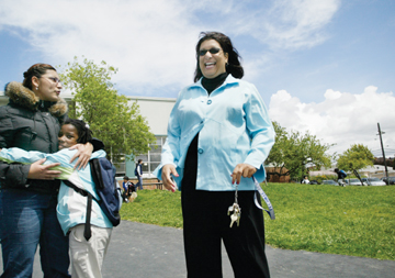 Jakob Schiller:LeConte Elementary School Principal Patricia Saddler helps funnel students out of class and onto their busses after school Monday afternoon while Iris Privitte, a third-grader at LeConte, gives third and fourth grade teacher Maria Carriedo a hug..