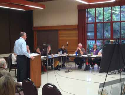 City Planning Director Dan Marks, standing at podium, talks at the May 6 meeting with the Landmarks Commission about historic review provisions of the City Council's proposed new Downtown Area Plan.