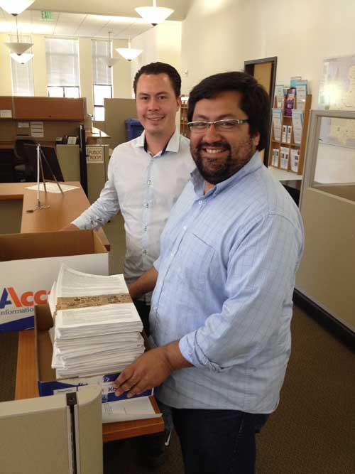 Councilmember Jesse Arreguin and his aide Anthony Sanchez deliver signed petitions to the Berkeley City Clerk.