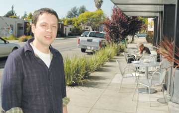 Richard Brenneman: Markos Moulitsas—Kos to his hordes of readers—enjoys a moment in the sun outside a South Berkeley coffee shop, before heading to his newly bought nearby home, where he runs the world's most popular political blog—dailykos.com—from his bedroom.