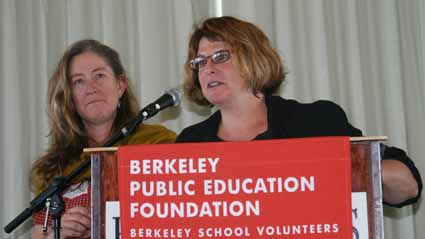 Cheese Board Collective members Cathy Goldsmith and Carrie Blake receive the Berkeley Public Education Foundation's award for distinguished business partner.