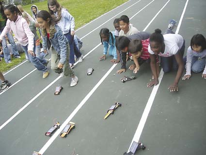 Fourth-graders at Rosa Parks test their solar cars a day before racing them at the school's Solar Fair. Photograph by Riya Bhattacharjee.