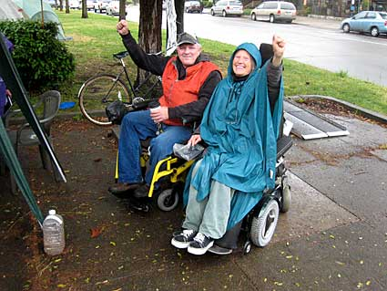 Dan McMullan and Jean Stewart, at Berkeley's Arnieville encampment, say they're ready to continue the struggle until Governor Schwarzenegger's budget threats are defeated.