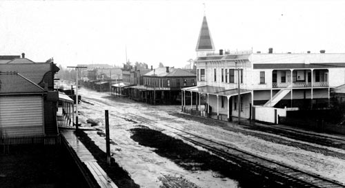 Shattuck Ave. in November 1892. The Fischel Block is on the right, the Antisell Block across the street, and the Acheson Hotel on the left.