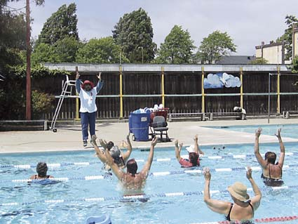 Yassir Chadly energizes water aerobics students at the West Berkeley Swim Center on Tuesday. Photograph by Judith Scherr.