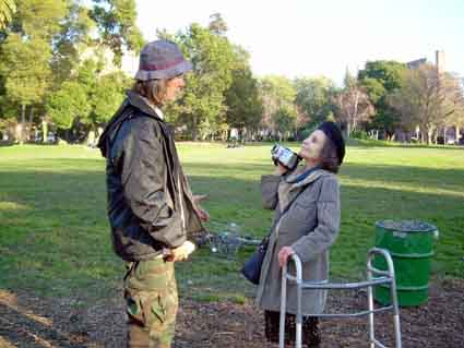 Claire Burch, seen here interviewing a man at People's Park, was rarely seen without a video camera in hand.