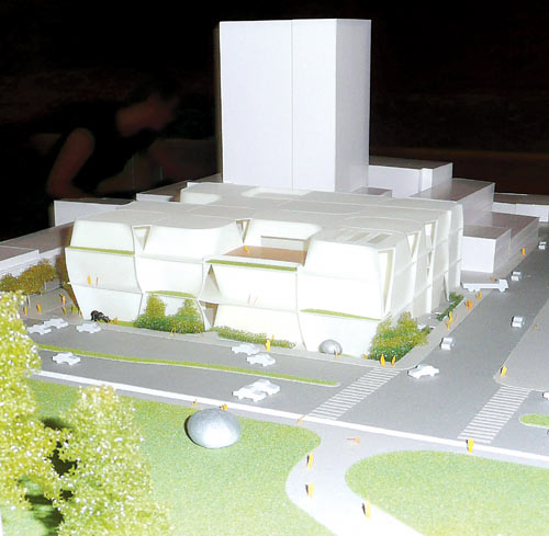 A model of the planned Berkeley Art Museum/Pacific Film Archive building as seen from campus, with University Avenue on the right and the proposed high rise hotel, condo tower and conference center to the rear.