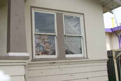 Two young girls were injured when gunfire pierced the glass of the Oregon Street bedroom where they slept.