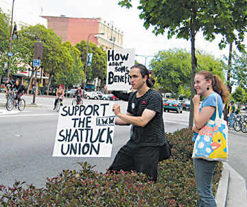 Workers at Shattuck Cinemas rally in support of unionization outside the theater Wednesday.