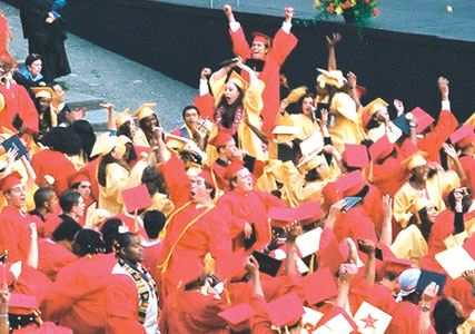 BERKELEY HIGH GRADUATES celebrate at the Greek Theater after Friday's diploma ceremony.