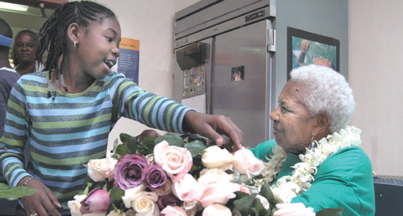 MAUDELLE SHIREK receives 92 roses from Berkeley children for her birthday. Below, she poses with another of her gifts, a money wreath.