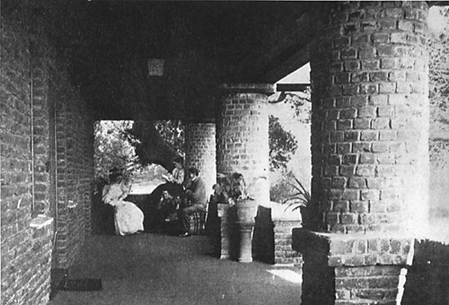 Mary Moody, her daughters, and a male cousin on the veranda, whose robust columns Schweinfurth replicated in redwood trunks in the First Unitarian Church.