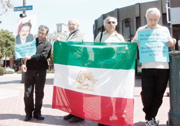 Cassie Norton: A group of Berkeley residents of Iranian descent gathered at the corner of Center St. and Shattuck Ave. near the BART station to protest the ongoing presidential elections in Iran. The protest's organizer, Ali Mirab, is pictured second from the left..