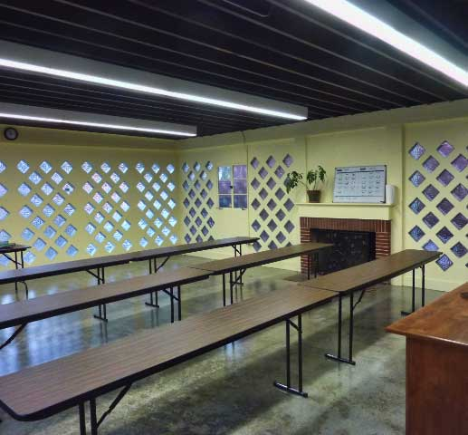 A classroom in the renovated 1007 University Avenue building retains a fireplace and glass block walls from the original use as a community center.