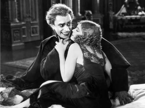 Conrad Veidt and Olga Baclanova in Paul Leni's The Man Who Laughs (1928), a film that expanded on the sympathetic portrayals of disfigured men that had been so successful on the screen in The Hunchback of Notre Dame and The Phantom of the Opera. The Man Who Laughs gave rise not only to the series of Universal horror films of the 1930s, but inspired the character of The Joker.