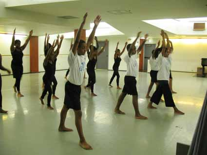 Teenagers practice dance moves at AileyCamp, where the goal is to teach them to value their bodies and themselves as individuals in the world.