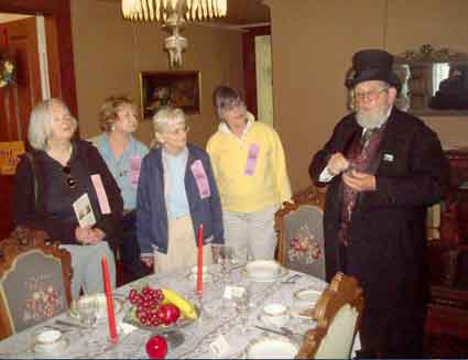 Docent Al Minard, in period costume, describes the intricacies of 19<sup>th</sup> century meals in the formal dining room.