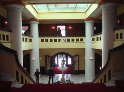 A view from the main stair landing looks down on the two story