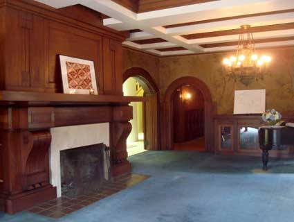 The original living room has one of several huge fireplaces in the