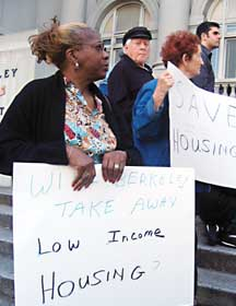 Berkeley resident Joyce Hawkins, a Section 8 tenant for 21 years, joined public housing advocates at Old City Hall Tuesday to show support for the Berkeley Housing Authority. Photograph by Suzanne La Barre.
