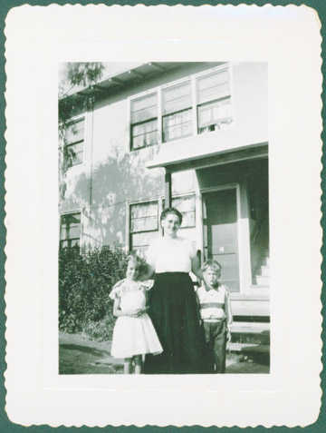 This photograph, donated by Bruce Elliott of San Leandro, shows his wife and kids in front of their former apartment on S. 45th Street in Richmond. Elliott was an electrician's helper at the shipyards. Contributed photo.