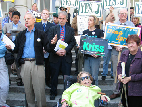 Councilmember Dona Spring joins Councilmember Kriss Worthington and Measure J supporters in a City Hall-step rally for their 2006 re-election. They then marched to the nearby Chamber of Commerce building to denounce huge independent expenditures of the Chamber PAC against Spring, Worthington and Measure J. The PAC has since been disbanded.