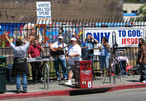 SOS Ministries, which sets up its amplifiers at Haste Street and Telegraph Avenue, say its making music and preaching to save souls. Nearby merchants want them muzzled.