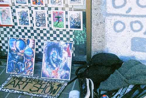 The Traveling ART SHOW,  from Santa Monica sets up at Cody's. The artists ducked out of the pic, but not before reporting on the homeless scene in S.M. Their travel-gear can be seen in the hump on the right.