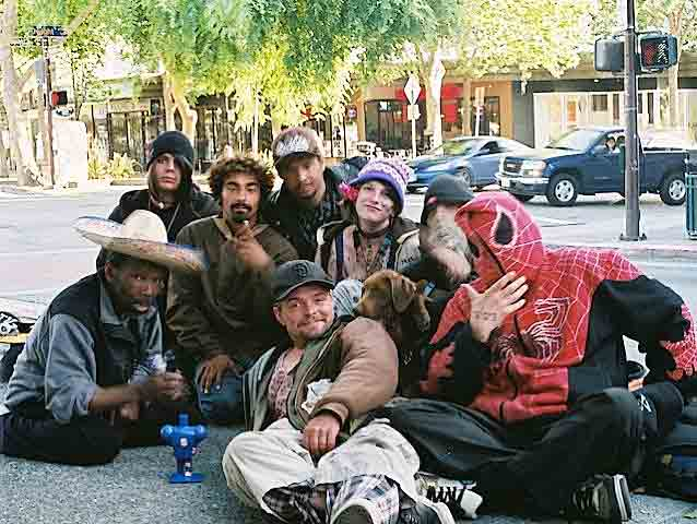 "A recent gathering of our street kids on Telegraph, late afternoon; the young woman in the blue hat is a ""street beauty- queen"" from Santa Cruz, who alternates with Berkeley. Spiderman is incognito."