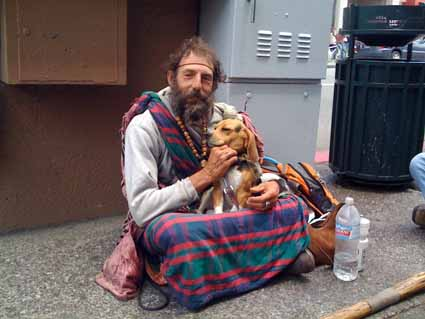 Russell Grant, who has been homeless for 20 years, sits with his dog Gabriel outside Smart Alec's on Telegraph Avenue.