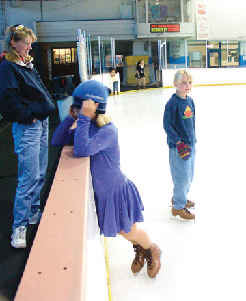 Matthew Artz: Erica Hanafee, 8, and Mira Chaplin, 8, (with hat) skate Monday afternoon at Berkeley Iceland as Linda Hanafee watches..