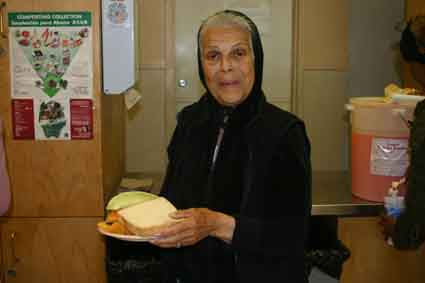 Ms Wong, who at 83 is the shelter's oldest resident, picks up her chicken salad sandwich lunch from the dining room last Friday.