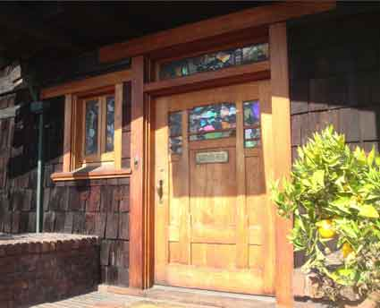 The main entrance features intricately crafted wood and art class windows.